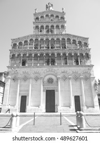 Black and white shot of facade of Lucca cathedral in northern Italy