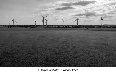Black and White Shot of Windfarm in Horizon