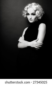 Black and white shot of woman with retro hairstyle and makeup looking like Marlene Dietrich, soft focus