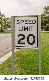 Black and white sign for 20 mph speed limit