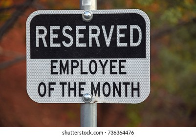 Black- and white sign at a reserved parking space for the employee of the month