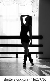 Black and white silhouette of dancing women in dance class.
