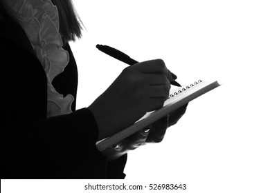 black and white silhouette of a female hand writing with a fountain pen on a piece of paper, it is possible to sign the document or writing application