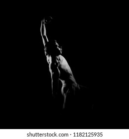 Black and white silhouette of male ballet dancer.