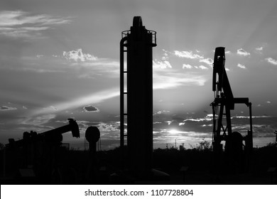 black and white silhouette of oilfield