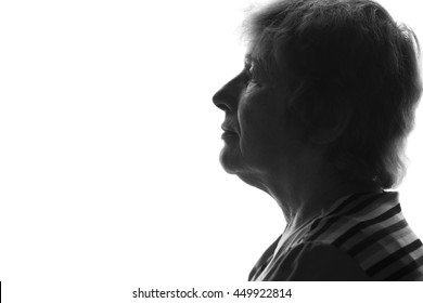 black and white silhouette of an old woman on an isolated background