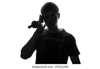 black and white silhouette of a young man who listens to music attach to your ear headphone speakers
