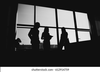 Black and white silhouettes of lawyers talking about decision.