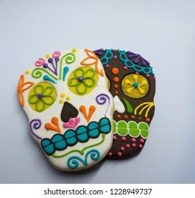 black and white skeleton head cookies on white background