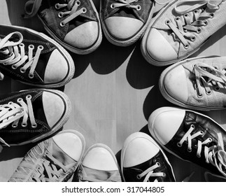 Black and white sneakers standing in the circle, view from above
