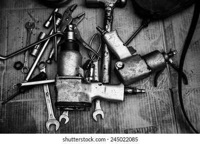 black and white spanner tools piled in workshop