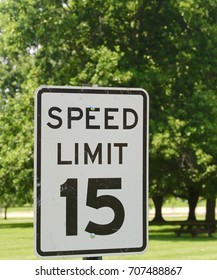 The black and white speed limit sign on a close up view.