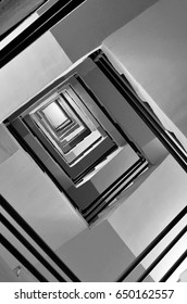 Black and white staircase fire escape,square stair perspective, abstract architecture.