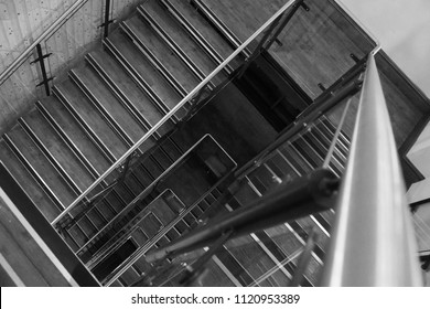 Black and white staircase rectangle. Beautiful spiral staircase going up.