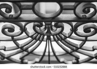 Black and white steel fence with great decoration curves