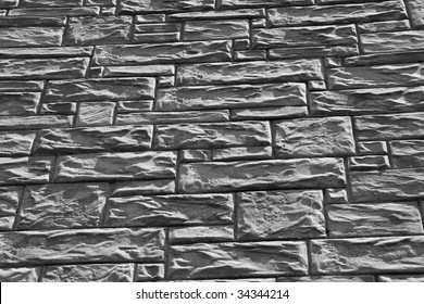 Black and white stone bricks on a wall
