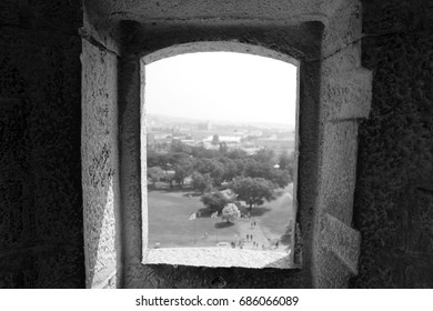 Black and white stone window with a view to the field