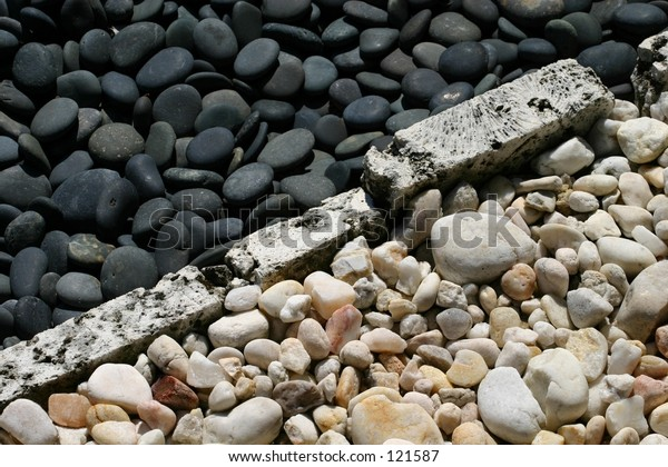 Black and white stones trim a zen rock garden.