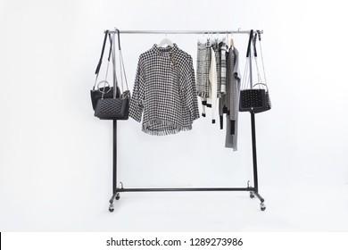 black and white stripy clothes ,sundress with black handbag , stripy skirt on hanger