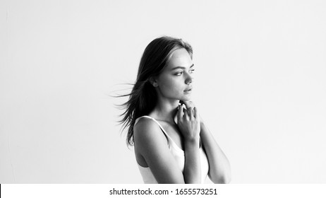 Black and white studio portrait of beautiful young woman.