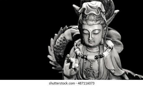 Black and white style of Buddha statue with light dark background . buddha image used as amulets of Buddhism religion.
