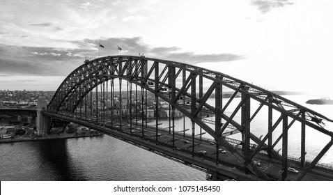 Black and white sunset aerial view of Sydney Harbour Bridge, NSW - Australia.