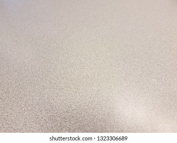 black and white table surface with reflection