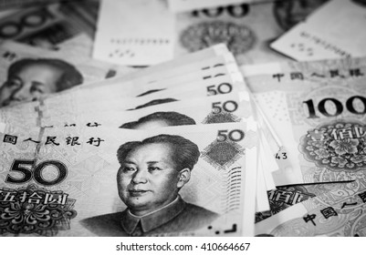 Black and white texture and background of chinese yuan currency,money banknotes,Focus on eye of Mao Zedong on the first banknote
