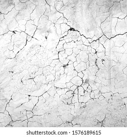 Black and white texture background wall of caraked soil material house.
