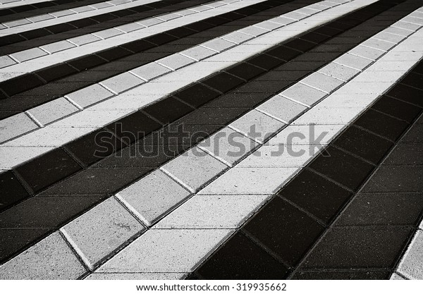 Black and white texture of perspective colored checkered tile in the street