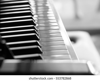 Black and white tone. Closeup of piano in the room