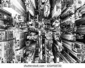 Black and white top down view of the very densly populated North Point district in Hong Kong island with many tall apartment building and some office tower in Hong Kong SAR, China