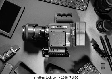 Black and White Top View of Creative Filmmakers Office Desk Camera and Supplies
