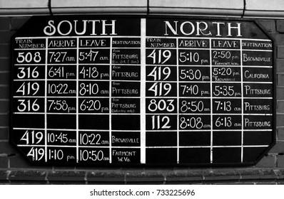 Black and White Train Station Board