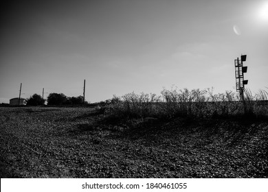 black and white traintracks sun horizon