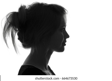 Black and white trendy portrait profile silhouette of face of a beautiful young woman with a hairdo on her head