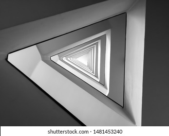 Black and white triangle spiral pattern minimal modern architecture abstract