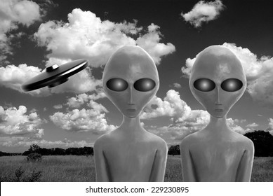 Black and white two alien newcomers on a wilderness and flying spaceship on sky with clouds