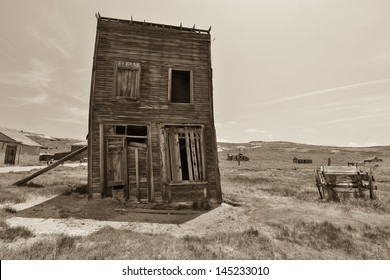 Black and white two story vertical house in the field