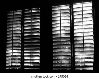 black and white version of shuttered windows