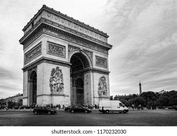 Black and white view of the Arc de Triomphe with the Eiffel Tower in the background from the Champs Elysees in Paris, France on 26 August 2018
