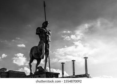 Black and white view of the Centaur statue of the Polish sculptor Igor Mitoraj at Pompei Forum. Pompei, Campania, Italy, October 2019