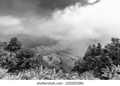Black and white view of clouds and pastures in the Sete Cidades caldera in Sao Miguel, Azores.