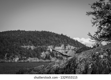 A black and white view of Deception Pass bridge at Deception Pass State Park in Washington.