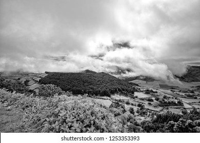 Black and white view of the dramatic clouds over the Caldera of Alferes near the town of Sete Cidades in Sao Miguel.