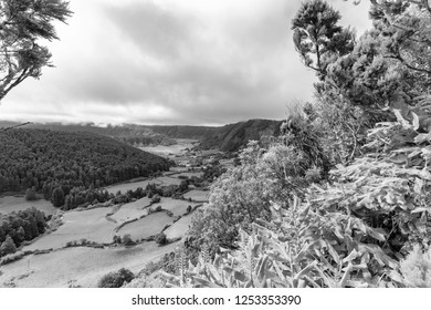 Black and white view of farmland and pastures in the Sete Cidades caldera in the Azores.