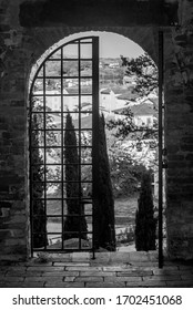Black and white view of the historic center of Fucecchio, Florence, Italy, framed by one of the ancient access doors to the Corsini Park