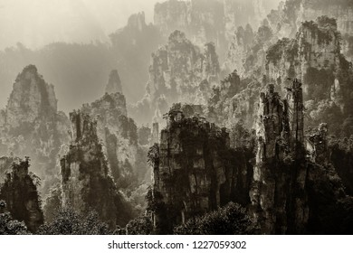 Black & white view of iconic quartzite pillars & peaks in Wulingyuan / Zhangjiajie National Forest Park in Hunan Province, China. Unique mountain landscape inscribed as UNESCO World heritage site