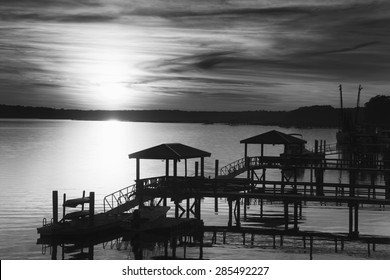 """""""Black and White View of the May River in SC"""" A few minutes before sunset on a beautiful March evening in Bluffton South Carolina, overlooking the docks on the May River at high tide."""