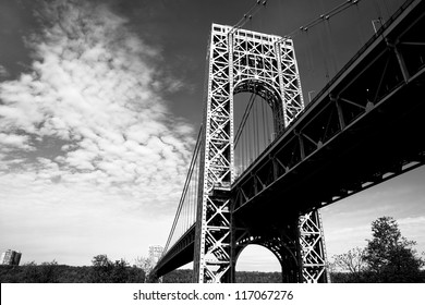 A black and white view of the New York City George Washington Bridge as seen from below.